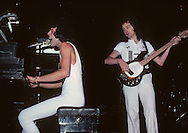 LOS ANGELES, CA - FEBRUARY 25: Freddie Mercury and John Deacon of Queen in concert at The Forum on February 25, 1977 in Los Angeles, California.
