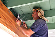 In order to solve my pigeon problem, I called We Gotta Guy, a Tucson-based contractor referral service. They sent handyman Jesse Micander. Here he is, on the pigeon deterrent installation job.