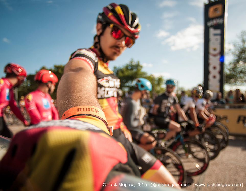 Riders prepare for the mens qualifying session during the Red Hook Crit on the Greenwich Peninsular, London. July 12, 2015.