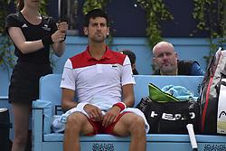 June 23, 2018 - London, England, United Kingdom - Novak Djokovic of Serbia sits during the semi final singles match on day six of Fever Tree Championships at Queen's Club, London on June 23, 2018. (Credit Image: © Alberto Pezzali/NurPhoto via ZUMA Press)