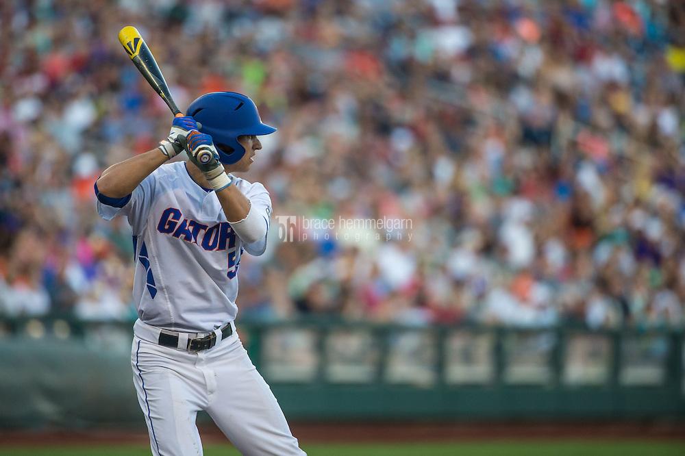 Dalton Guthrie (5) of the Florida Gators bats during a game between the Miami Hurricanes and Florida Gators at TD Ameritrade Park on June 13, 2015 in Omaha, Nebraska. (Brace Hemmelgarn)