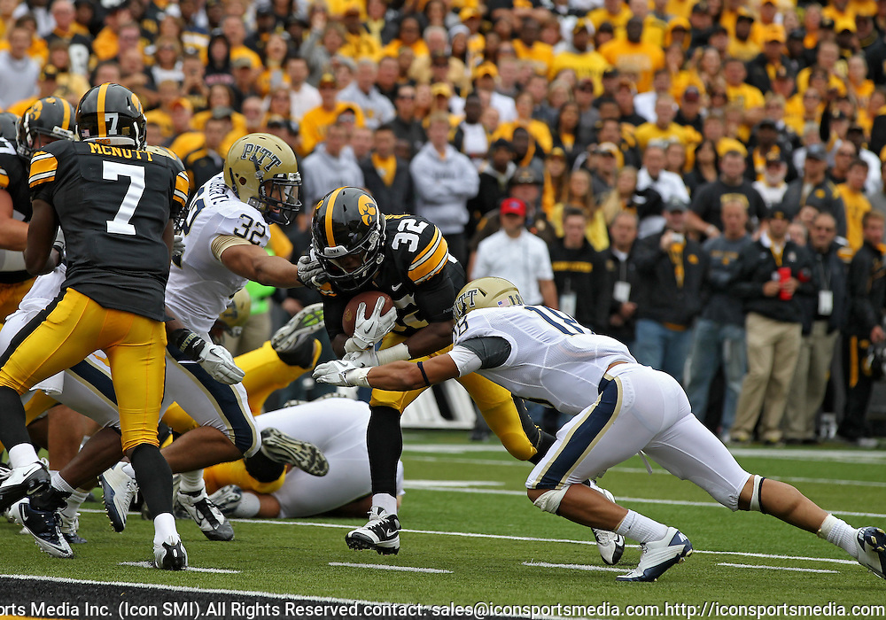 September 17, 2011: Iowa Hawkeyes running back Damon Bullock (32) fights for the goal line as Pittsburgh Panthers defensive back Jarred Holley (18) closes in during the second half of the game between the Iowa Hawkeyes and the Pittsburgh Panthers at Kinnick Stadium in Iowa City, Iowa on Saturday, September 17, 2011. Iowa defeated Pittsburgh 31-27.