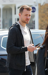Liverpool goalkeeper Simon Mignolet is spotted in Hale Village, Cheshire on Monday afternoon.