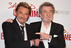 File photo : Johnny Hallyday, and Eddy Mitchell attend Salaud On T'Aime premiere held at the Cinema UGC Normandie in Paris, France on March 31, 2014. France's biggest rock star Johnny Hallyday has died from lung cancer, his wife says. He was 74. The singer - real name Jean-Philippe Smet - sold about 100 million records and starred in a number of films. Photo by Thierry Orban/ABACAPRESS.COM