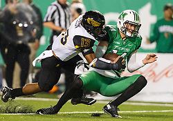 Oct 9, 2015; Huntington, WV, USA; Marshall Thundering Herd quarterback Chase Litton is tackled near the goal line by Southern Miss Golden Eagles defensive back Picasso Nelson Jr. during the first quarter at Joan C. Edwards Stadium. Mandatory Credit: Ben Queen-USA TODAY Sports