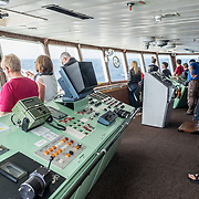Crew and passengers watch for seabirds and other marine wlidlife from the bridge of the Polar Pioneer on Drake Passage enroute to the Antarctica Peninsula.