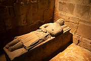 Tomb in Abbey Church at Fontfroide Abbey near Narbonne, France. Fontfroide Abbey is a former Cistercian monastery in France, situated 15 kilometers south-west of Narbonne. It was founded in 1093 by Aimery I, Viscount of Narbonne, but remained poor and obscure, and needed to be refounded by Ermengarde, Viscountess of Narbonne. The abbey fought together with Pope Innocent III against the heretical doctrine of the Cathars who lived in the region. It was dissolved in 1791 in the course of the French Revolution. The premises, which are of very great architectural interest, passed into private hands in 1908, when the artists Gustave and Madeleine Fayet dAndoque bought it to protect the fabric of the buildings from an American collector of sculpture. They restored it over a number of years and used it as a centre for artistic projects. It still remains in private hands. Today it is open to paying guests.