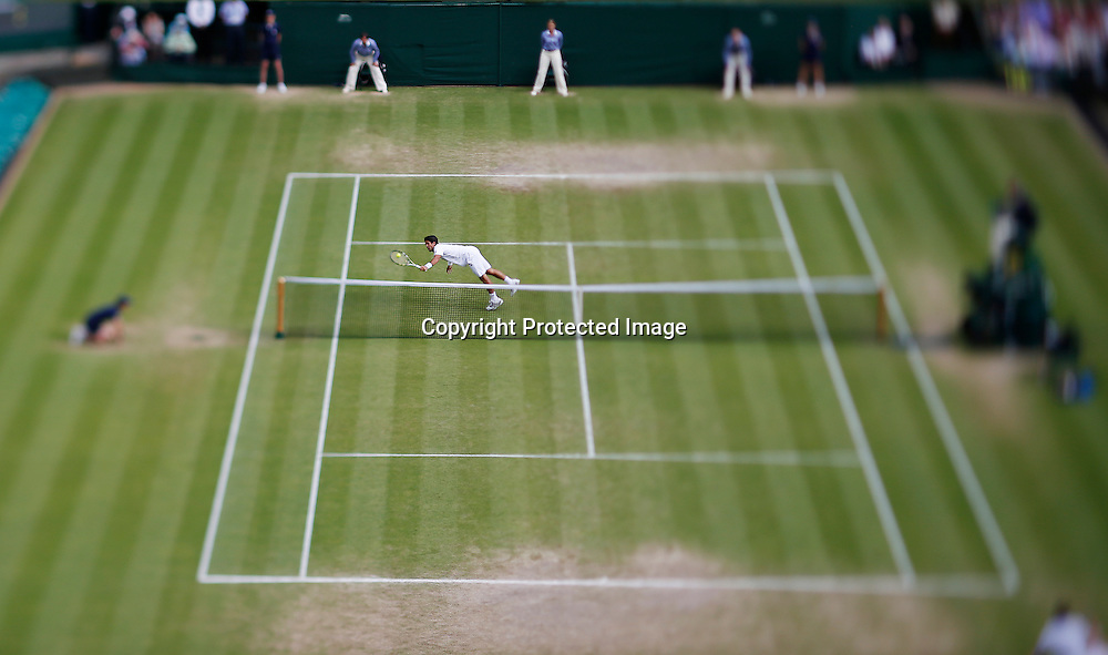 Fernando Verdasco of Spain misses a return to Andy Murray of Britain during their quarter-final match for the Wimbledon Championships at the All England Lawn Tennis Club, in London, Britain, 03 July 2013.  EPA/KERIM OKTEN