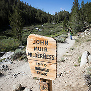 Sign showing entry into the John Muir Wilderness, a popular trail for hikers.