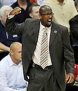 Cleveland Cavaliers head coach Mike Brown pumps his fist as he watches his squad on defense in the first quarter.