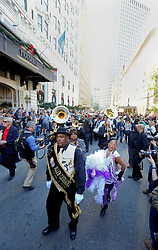 20 November 2015. Orpheum Theater, New Orleans, Louisiana. <br /> Memorial service for musician Allen Toussaint. <br /> Mourners send line their way along the street ahead of the hearse.<br /> Photo; Charlie Varley/varleypix.com