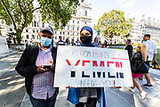 People most of them wearing surgical face masks are taking part in a protest demanding the end of the war in Yemen in Parliament Square on Sunday, 12 July 2020. (VXP Photo/ Vudi Xhymshiti)