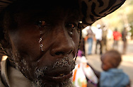 Local hero, Kutey Nuku, 82, cries while listening to a revolutionary song, during celebrations of the Referendum for independence in the village of Ayod in South Sudan, considered by historians as the spark place of the revolutionary movement that decades later archived the separation from Sudan. (PHOTO: MIGUEL JUAREZ LUGO).
