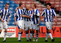 Photo: Glyn Thomas.<br />Huddersfield Town v Welling United. The FA Cup. 06/11/2005.<br />Huddersfield's Andrew Booth (second from L) is congratulated by teammates after scoring his team's third goal.