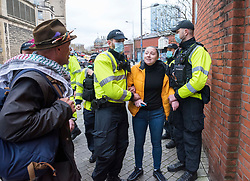© Licensed to London News Pictures; 14/11/2020; Bristol, UK. Police arrest a woman who was at the front of an Anti-Lockdown protest march and rally by Stand Up Bristol and StandUpX2, against the Covid-19 lockdown during the coronavirus pandemic, taking place on College Green in front of Bristol City Hall. Protests have been declared illegal under the current Covid-19 lockdown as people are not allowed to meet in more than groups of two and police have threatened arrests and fines against those attending. Police arrested several people. The protest is against Lockdowns, Isolation of the Elderly, Ruined Childhoods, Business Closures, Masks, Government Interference in Private Life and is part of a series of protests today in Sheffield, Wolverhampton, Portsmouth, Bristol and Bournemouth. England is under a national lockdown, sometimes known as lockdown 2.0, as the UK Government tries to stop the spread of the covid-19 coronavirus pandemic. From 05 November lockdown restrictions came into force across England with all pubs, bars, restaurants and entertainment venues shut as well as all non-essential shops. People have been told to stay at home except for work, education, exercise or essential shopping and each person can only meet one other person from outside their household in an outdoors public space. Photo credit: Simon Chapman/LNP.