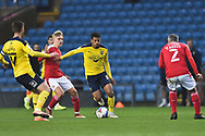 Oxford United midfielder Marcus McGuane (18) battles for possession with Swindon Twn Midfielder Matthew Smith (15) during the EFL Sky Bet League 1 match between Oxford United and Swindon Town at the Kassam Stadium, Oxford, England on 28 November 2020.