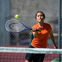 041513    Brian LEddy<br /> Gallup Bengal Samantha Enos returns a serve during a match against Rehoboth Monday afternoon.