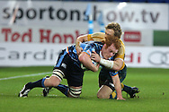 Cardiff Blues v Australia at the Cardiff City Stadium on Tuesday 24th Nov 2009. pic by Andrew Orchard, Andrew Orchard sports photography. Cardiff Blues Paul Tito is tackled by Ryan Cross of Australia