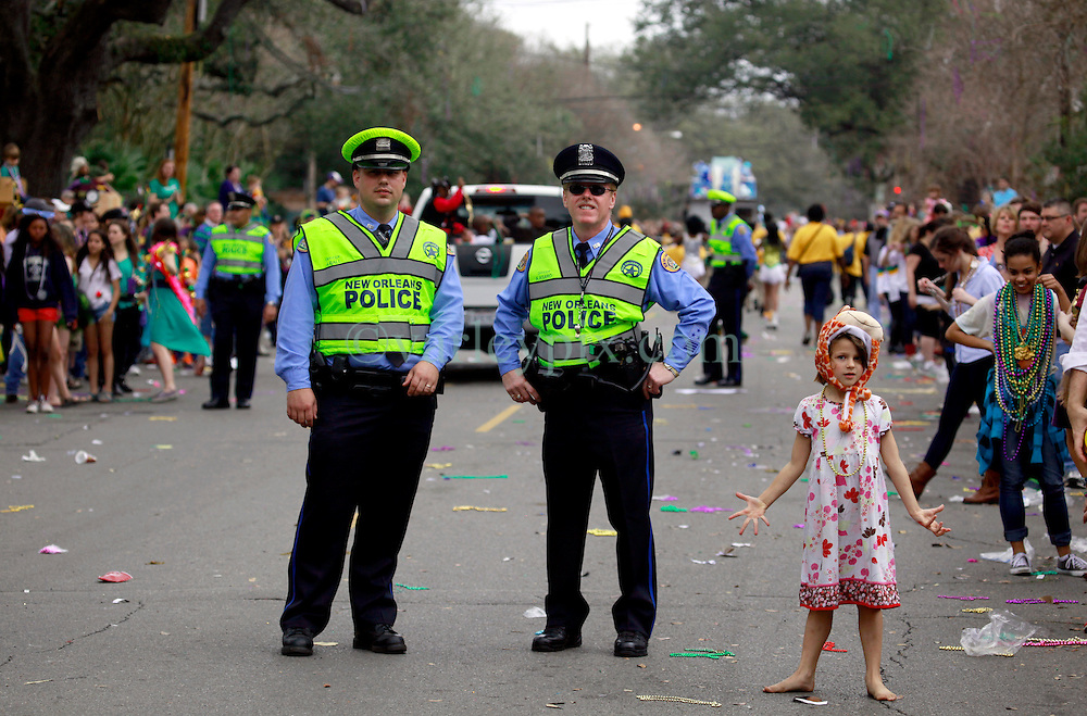 10 February 2013. New Orleans, Louisiana. .Mardi Gras. The Krewe of Thoth, in existence since 1947 parades through Uptown New Orleans. Officers from NOPD keep an eye on proceedings..Photo; Charlie Varley.