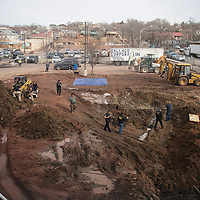 Gallup Police detectives and medical investigators search for bones in the parking lot of the McKinley County Courthouse in Gallup Friday afternoon after construction crews find them Friday morning.