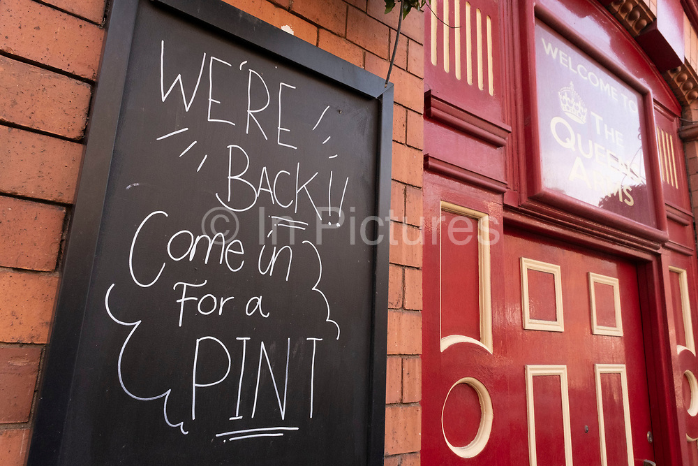 As the third national coronavirus lockdown continues, and as the country enjoys the first days of the easing of lockdown restrictions, one pub anticipates its return with a sign saying Come in for a pint on 30th March 2021 in Birmingham, United Kingdom. After months of lockdown, the first signs that life will start to get back to normal begin, with more people enjoying the company of others in public, as the rule of six starts the first stage of lockdown ending.