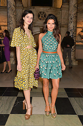Left to right, sisters EVANGELINE LING and BIP LING at a VIP preview of the V&A's new exhibition 'The Glamour of Italian Fashion' - a comprehensive look at Italian Fashion from 1945-2014 held at The Victoria & Albert Museum, London on 2nd April 2014.
