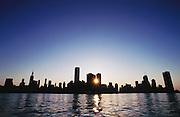 Chicago skyline at sunset, seen from Lake Michigan, Illinois, USA.
