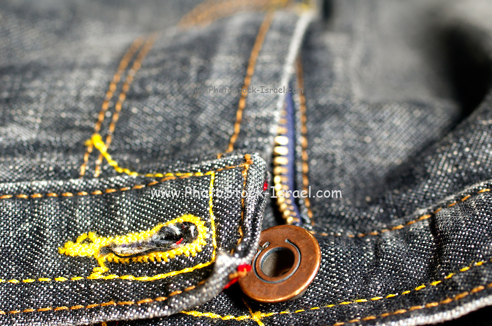 Selective focus close up on brandless black Jeans Button and zipper