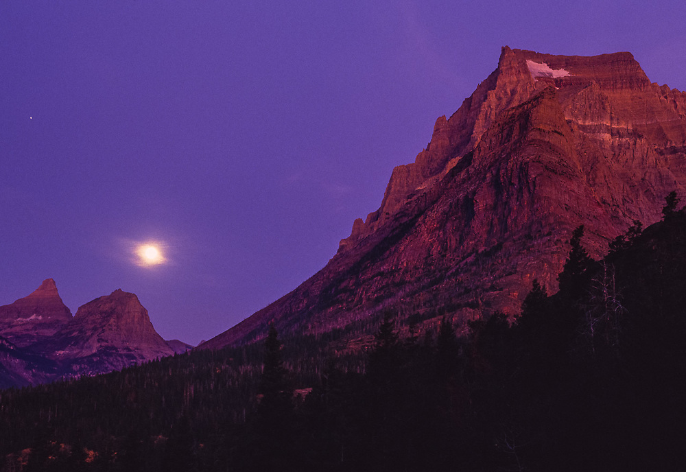 Moonset viewed from Sun Point, Glacier National Park, Montana, USA