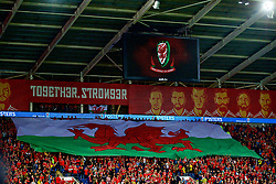 CARDIFF, WALES - Monday, October 9, 2017: Wales supporters with a giant red dragon flag in the stands before the 2018 FIFA World Cup Qualifying Group D match between Wales and Republic of Ireland at the Cardiff City Stadium. (Pic by Paul Greenwood/Propaganda)