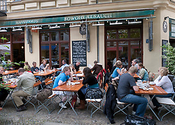 Busy pavement cafe in bohemian Prenzlauer Berg district of Berlin
