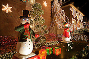 Mechanical snowmen with eerie glowing eyes in Dyker Heights.