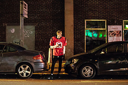 © Licensed to London News Pictures . 28/10/2018. Manchester, UK. A man dressed up as an American Footballer on Sackville Street in Manchester City Centre . Revellers on a night out , many in fancy dress , on the weekend before Halloween . Photo credit: Joel Goodman/LNP