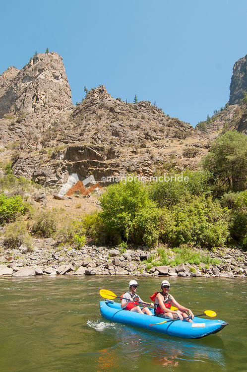Kayaking in The Impassible Canyon on the Middle Fork of the Salmon River during six day rafting vacation, Idaho.