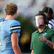 ORLANDO, FL - OCTOBER 24: Quarterback Michael Pratt #7 of the Tulane Green Wave speaks with a face mask wearing coach against the Central Florida Knights at Bounce House-FBC Mortgage Field on October 24, 2020 in Orlando, Florida. (Photo by Alex Menendez/Getty Images) *** Local Caption *** Michael Pratt