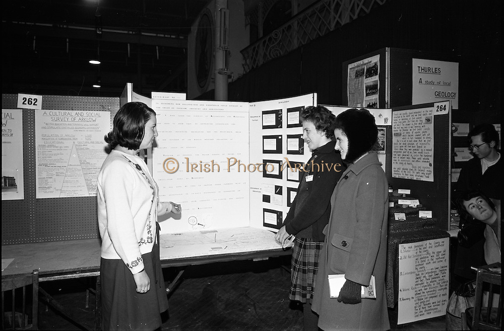 04/01/1967.01/04/1967.4th January 1967 .The third annual Aer Lingus Young Scientist Exhibition at the RDS..Francis Marie Sheehan from Loreto Abbey Rathfarnham Dublin. Her exhibit was in the geography section (for Senior girls) it was entitled 'To determine how Ballyheigue and Kerryhead could develop by the union of Tourism, Industry and Agriculture.' Here she is explaining her exhibit to  two students from Loreto College, Beaufort, Dublin. .....
