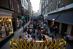 © Licensed to London News Pictures. 16/04/2021. London, UK. Members of the public enjoy food and drink in Soho in Central London. Earlier this week Lockdown restrictions were eased to allow non essential retail and outdoor dining to reopen. Photo credit: George Cracknell Wright/LNP