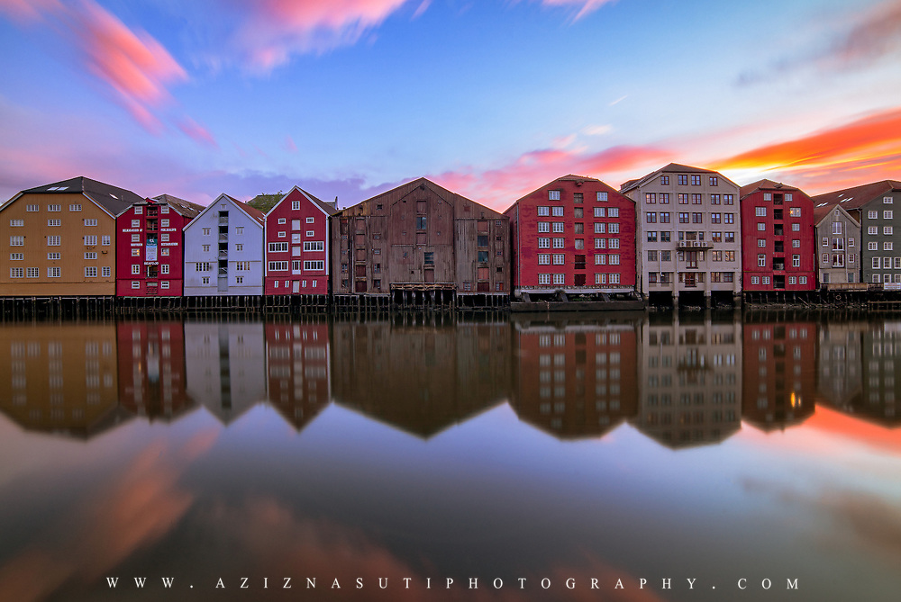 """website: www.azinasutiphotography.com                               At Nidelva's outlet there have been seaside stalls, breweries and warehouses all the way from the oldest times. Here the towners traded with goods from far and near.<br /> <br /> At the time of King Sverres, the bridges were also used as defense works. Towards the river, screens and times were built. From here you could throw stones on the enemy. In Magnus Lagabøte's city council of 1276, it is stated that the swallow, a passageway outside the bridges, should not be wider than three ales; further that between the brews should be """"droplet"""" distance. The brewery that is still preserved is located on both sides of Nidelva - in Kjøpmannsgata, in Bakklandet, in Fjordgata and Sandgata. The oldest preserved breweries are from the mid-18th century."""