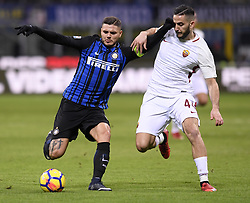 MILAN, Jan. 22, 2018  Inter Milan's Mauro Icardi (L) competes with Roma's Kostas Manolas during a Serie A soccer match between Inter Milan and Roma in Milan, Italy, Jan. 21, 2018. The game ends with a 1-1 tie. (Credit Image: © Alberto Lingria/Xinhua via ZUMA Wire)