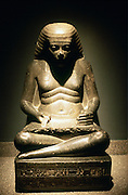 Ancient Egyptian scribe, seated. Granite statue from Karnak, 17/18th dynasty c1500 BC.