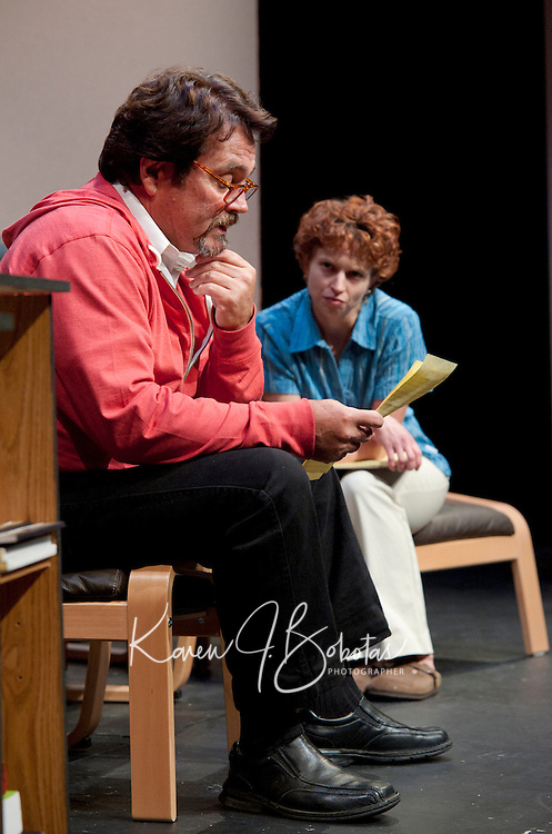 """Jim Rogato as Nick/Fireman reads through notes written by Katie Dunn as Joan/the Editor as they work together in writing eulogies for the fallen firefighters of 9/11 during the dress rehearsal of """"The Guys"""" at the Winnipesaukee Playhouse on Wednesday evening.  (Karen Bobotas/for the Laconia Daily Sun)"""