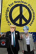 On US President Donald Trumps second day of a controversial three-day state visit to the UK, a Trump and Theresa May figures stand beneath a CND banner, as protesters voice their opposition to the 45th American President, in Trafalgar Square, on 4th June 2019, in London England.