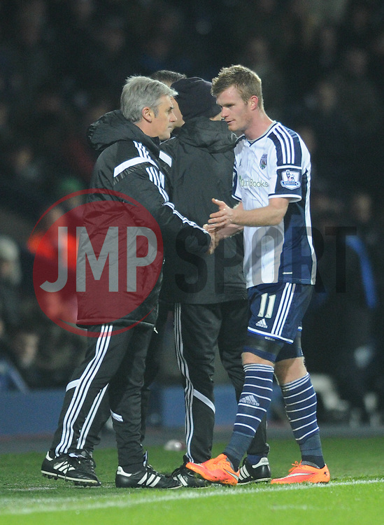 West Bromwich Albion's Chris Brunt shakes West Bromwich Albion Manager, Alan Irvine's hand before leaving the field after picking up an injury - Photo mandatory by-line: Dougie Allward/JMP - Mobile: 07966 386802 - 02/12/2014 - SPORT - Football - West Bromwich - The Hawthorns - West Bromwich Albion v West Ham United - Barclays Premier League
