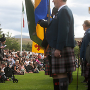 Highland Games, 3rd of August 2019, Newtonmore, Scotland, United Kingdom. Opening speeches ahead of the games. The Highland Games is a traditional annual event where competitors compete as strong men, runners, dancers, pipers and at tug-of-war. The games go back centuries and are happening through-out the summer across Scotland. The games are both an important event locally and a global tourist attraction.