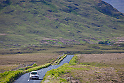 Tourist on Kylemore Pass by the Twelve Bens mountains, Connemara, County Galway, Ireland