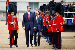 © Licensed to London News Pictures. 12/07/2017. London, UK. King Felipe VI of Spain and Prince Philip, The Duke of Edinburgh inspect Ceremonial Guard of Honour on Horse Guards Parade in London on the first day of State visit of the King and Queen of Spain. Photo credit: Tolga Akmen/LNP