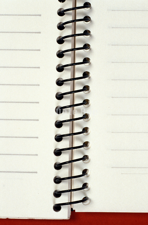 close up of spiral notebook spring with lined pages