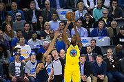 Golden State Warriors forward Kevin Durant (35) shoots a three pointer against the Minnesota Timberwolves at Oracle Arena in Oakland, Calif., on January 25, 2018. (Stan Olszewski/Special to S.F. Examiner)