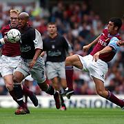 Liverpool's El-Hadji Diouf is tackled by Aston Villa's Mark Delaney