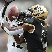 ORLANDO, FL - NOVEMBER 21:  Ahmad Gardner #12 of the Cincinnati Bearcats breaks up a pass reception by Jaylon Robinson #1 of the Central Florida Knights at Bounce House-FBC Mortgage Field on November 21, 2020 in Orlando, Florida. (Photo by Alex Menendez/Getty Images) *** Local Caption *** Ahmad Gardner; Jaylon Robinson